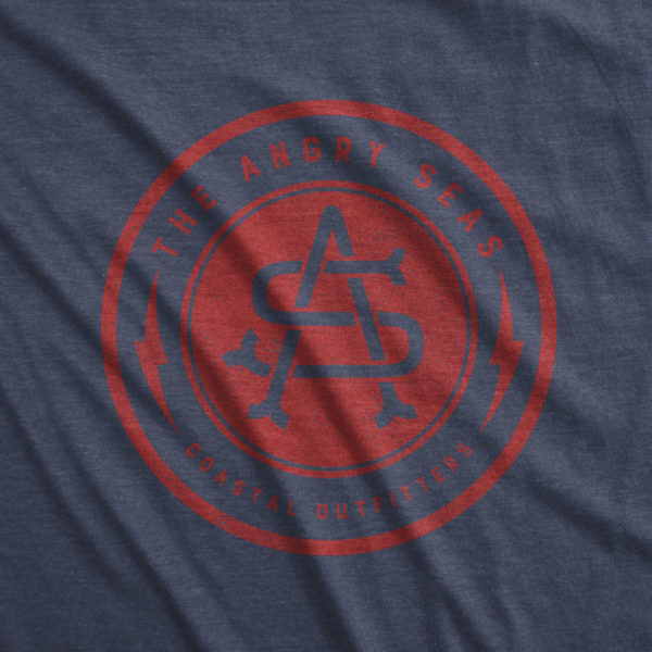 "Product: ""Bolt Badge"" Tri-Blend T-Shirt // Description: Angry Seas tee with monogram in crimson silkscreened design // Color: Vintage Navy // Brand: The Angry Seas - Fishing Apparel"
