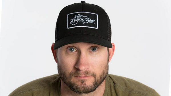 """Product: """"Signature Script"""" Snapback Hat // Description: Semi-Curved Bill mesh snapback hat with woven label appliqué // Color: Black on Black // Brand: The Angry Seas Clothing"""