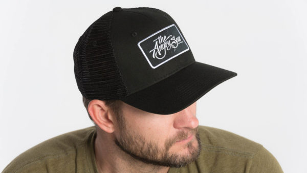 "Product: ""Signature Script"" Snapback Hat // Description: Semi-Curved Bill mesh snapback hat with woven label appliqué // Color: Black on Black // Brand: The Angry Seas Clothing"