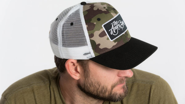 "Product: ""True Script"" Snapback Hat // Description: Semi-Curved Bill mesh snapback hat with woven label appliqué // Color: Camo on White // Brand: The Angry Seas Clothing"