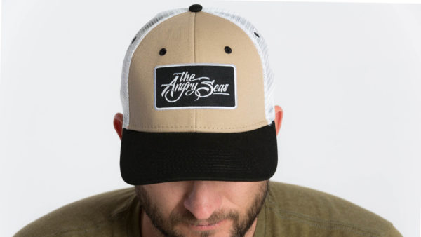 "Product: ""Ture Script"" Snapback Hat // Description: Semi-Curved Bill mesh snapback hat with woven label appliqué // Color: Khaki on White // Brand: The Angry Seas Clothing"