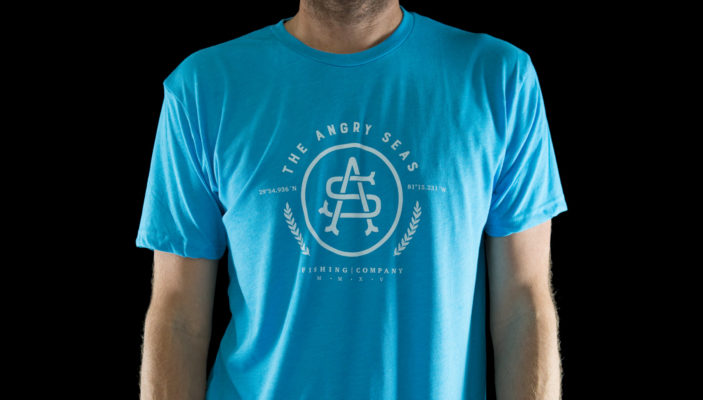 """Product: """"GPS"""" Tri-Blend T-Shirt // Description: Angry Seas tee with classic monogram silkscreened design // Color: Vintage Turquoise // Brand: The Angry Seas Clothing"""