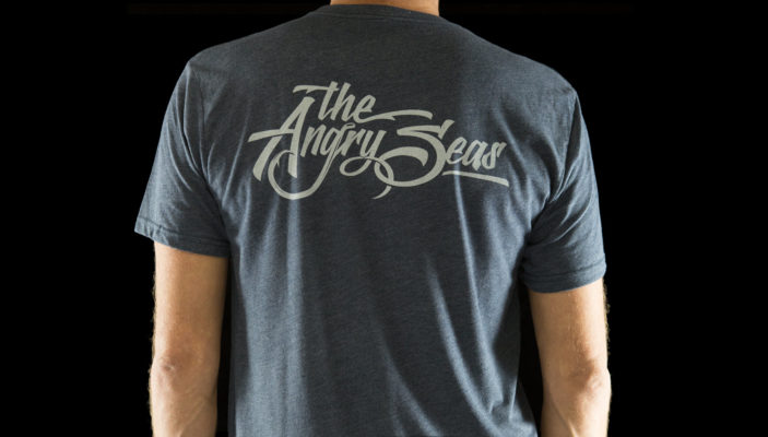"Product: ""SCRIPT LOGO"" Tri-Blend T-Shirt // Description: Angry Seas custom script lettering logo design silkscreened on tee // Color: Vintage Navy // Brand: The Angry Seas Clothing"