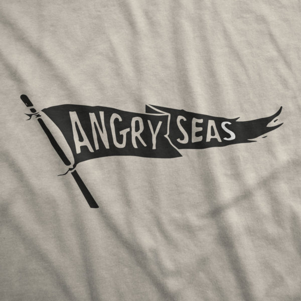 "Product: ""Black Flag"" 50/50 T-Shirt // Description: Angry Seas tee with raise the flag silkscreened design // Color: Sand // Brand: The Angry Seas Clothing"
