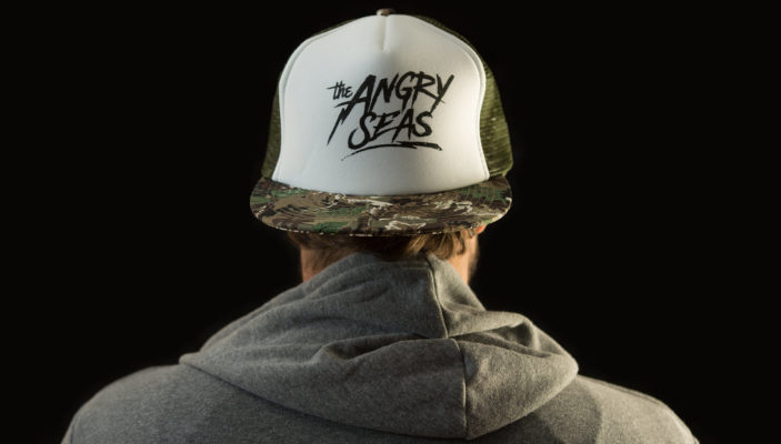 "Product: ""Lightning Strike"" Snapback Hat // Description: Flat Bill mesh snapback hat with silkscreen logo // Color: Camo and White // Brand: The Angry Seas Clothing"